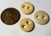 Three antique bone buttons, hand made